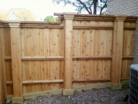 Step and level custom cedar fence solution